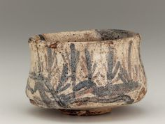 Mino ware tea bowl with design of gate and seedling pines, late 16th century Stoneware with iron pigment under Shino-type feldspathic glaze; gold lacquer repairs