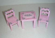 Dollhouse Miniature Victorian Nursery: Pink & White PLAY TABLE & 2 CHAIRS.    Dollhouse miniature furniture. One inch scale 1:12. A little play table and two chairs - perfect for a little girls nursery or bedroom. Hand-painted, signed by the artist. The set is painted a purply-pink (Id call it an orchid pink) - with a pink and white striped border and tiny Victorian roses. So charming - so sweet. Table is approx 2.25 inches long, just under 2 inches wide and just under 2 inches tall. Chairs…
