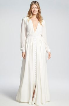 Boho goes va-va-voom with this flowy wedding dress with long sleeves. A column of tiny pearl buttons runs down the center of the skirt, letting you reveal as much leg as you like. If you love everything about the dress but the plunging neckline, layer a lace or satin camisole underneath.