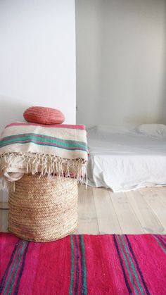 Vintage Rug handmade wool craft the Middle Atlas.    This vintage Moroccan striped blanket is an item fun colored with the hot pink, turquoise and