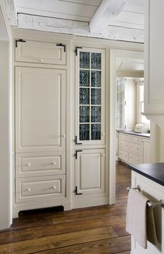 a bit heavy on the new england thing, but like the built-in cupboard idea and the wood floor