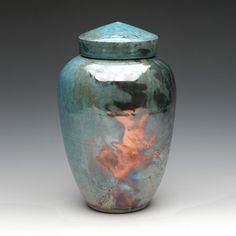The Imperial Blue Raku Ceramic Cremation Urn is handcrafted by an artisan in the traditional Raku ceramics process. Each piece is uniquely handcrafted in the USA.