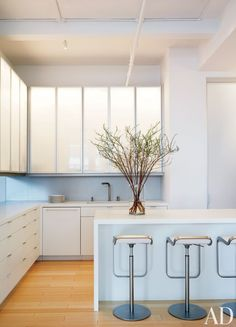 In a New York kitchen designed by Desai/Chia Architects, the upper cabinets feature custom-made Häfele doors of anodized aluminum and acrylic. Push latches can be installed right inside flush doors like these | archdigest.com