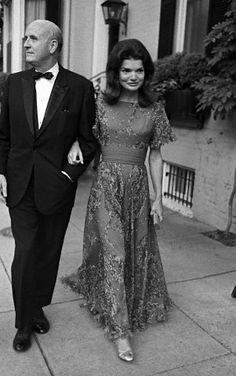 Jackie Onassis and George Stevens heading to a performance of Leonard Bernstein's mass composed for John F. Kennedy at the JFK Center, 1972.