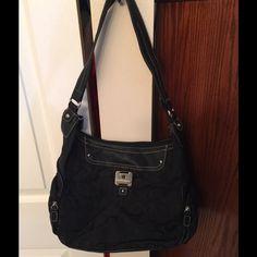 Rosetta Black Handbag Rosetta black patterned handbag. Has handle & zipper closure, 2 zippered pockets on the sides. Inside has a zippered pocket. Rosetti Bags Shoulder Bags