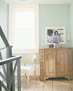 Blue Entry  The second-floor landing of this home features a large baroque cabinet from Sweden, which retains its original paint.   Get the look with Martha Stewart Living Paint Color in Love-In-A-Mist at the Home Depot.   Order a Tester of Love-In-A-Mist  Take a Tour of This Home
