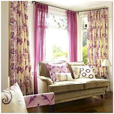 Mix of curtains around bay windows