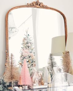 Pretty gold mirror with bottle brush Christmas trees.