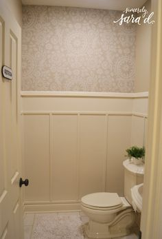 """Easy wall treatment for a bathroom - love the """"wallpaper"""" (it's actually starched fabric!)"""