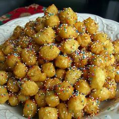 "Italian Honey Balls ~~~  ""Struffoli"" is a Neapolitan dish made with the sweetness of honey and/or other sweet ingredients!"