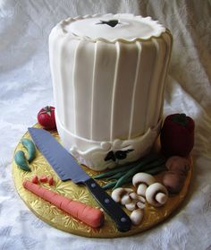 Fun cake to do.  All food is sculpted from fondant as well as the knife.