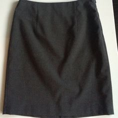 The Limited Collection gray pinstripe work skirt Really professional pinstriped skirt from the Limited. Has a side zipper and faint pinstripes with a modest slit in the back. Pet and smoke free home. The Limited Skirts Pencil