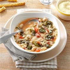 White Bean Soup with Escarole Recipe -This winter warmer has become a favorite because it uses kitchen staples, it's packed with healthy ingredients and is a cinch to prepare. If I can't find escarole, I sub fresh spinach at the very end of cooking. —Gina Samokar, North Haven, Connecticut