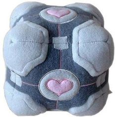 Official Valve Portal Weighted Companion Cube Plush.  When I have a kid, I GUESS he/she can snuggle/play with it, too.