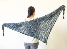 Stormy Sky is a lightweight, asymmetrical shawl, it's dynamic and modern. Knitted from the corner in a shape of a skewed triangle, it makes a great and fast project for that one very special skein of yarn. Alternation of sections creates nice texture and is rather easy to memorize. Tassels can be added to make corners look more polished.