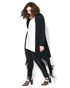 Fall for this fashionable plus-size cardigan from Melissa McCarthy! Made with a super soft cotton blend knit fabric, it features trendy fringe detailing, long sleeves and an open front. A must-have for your fall wardrobe, it layers perfectly over all your outfits!