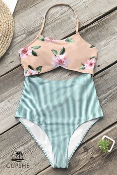777d0d9303 A sweet and chic style for your next girls trip. The Pink Floral And Green Striped  One-piece Swimsuit is cut out at the front for a surprise flirty touch.