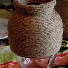 Covering a vase with rope for a new look.