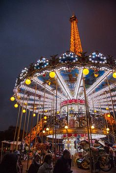 Eiffel Tower and Carousel by stevewhis.  The Eiffel Tower looms over a carousel in the heart of Paris, France.