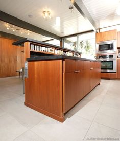 #Kitchen Idea of the Day: Naturally warm and inviting: Modern medium wood kitchens. Kitchen island storage and plank ceilings.