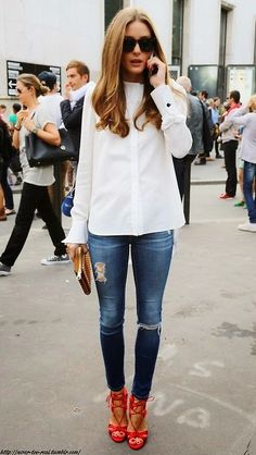 olivia's classic look with white top, blue jeans and red heels