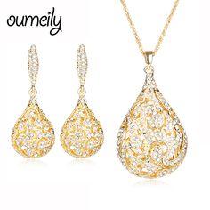 Oumeily قلادة تقليد الكريستال قلادة الأقراط الاكسسوارات الخرز الأفريقي طقم مجوهرات للنساء الزفاف مطلية بالذهب عطلة