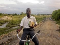 'Esaie riding his bike home from Church in Croix de Bouquets Haiti' ~ by Plan International USA