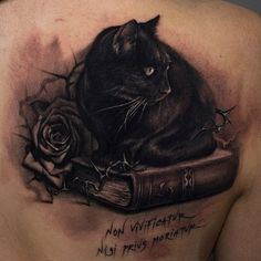 image of a tattoo of a woman reading a book | Black cat sitting on a book tattoo - Tattooimages.biz