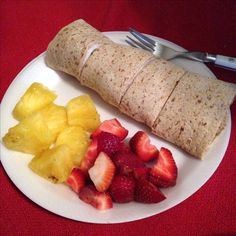 Whole grain turkey, provolone, cucumber wrap (1 yellow, 1 red, 1 blue, 1/2 green) & Strawberries and pineapples (1 purple)  21 day fix