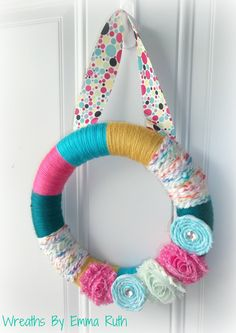 SALE Yarn Wreath Fun for Party polka dots, turquoise, pink, and yellow. $20.00, via Etsy. -- def a FAV. colors are so pretty for a little girls room.