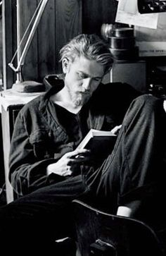 Charlie Hunnam reading...wonder what book it is?