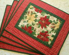 Quilted Christmas Poinsettia Placemats - Set of 4 Christmas Placemats, Christmas Fabric, Christmas Quilting, Place Mats Quilted, Holiday Images, Christmas Poinsettia, Holly Leaf, Quilted Table Runners, Gold Stripes