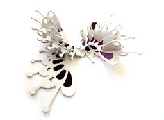 Lynne Maclachlan brooch - laser cut white acrylic - gaps were then filled with resin to give the 'plique-a-jour' colour effect - -   http://lynnemaclachlan.co.uk/