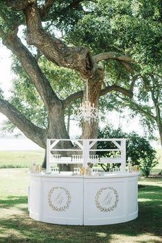 Elegant wedding cocktail hour idea - white, outdoor wedding bar with couple's monogram and hanging chandelier {Aaron and Jillian Photography}