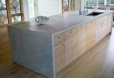 Concrete Countertops. (like the way the side and to seem a single piece, would use a diferent veneer)