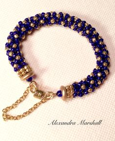 I'll take this one .  Sized to fit a 6 1/2  wrist, this cobalt blue and gold seed beaded tubular herringbone and chenille stitch bracelet by Alexandra