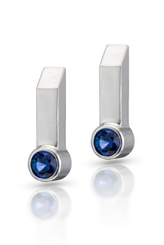 Sterling silver rectangular bar earrings with blue sapphires.