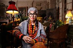 The extravagant Iris Apfel posing on a bright atmosphere, surrounded by an exquisite interior decoration
