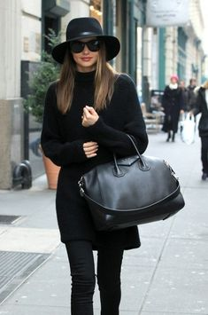 Miranda Kerr looked super chic as she stepped out of her apartment wearing all black attire and a Givenchy handbag in New York, New York on December 2, 2012.