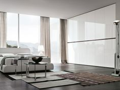 schlafzimmer mit verglaster-wand weiß-kleiderschrank weiss glanz