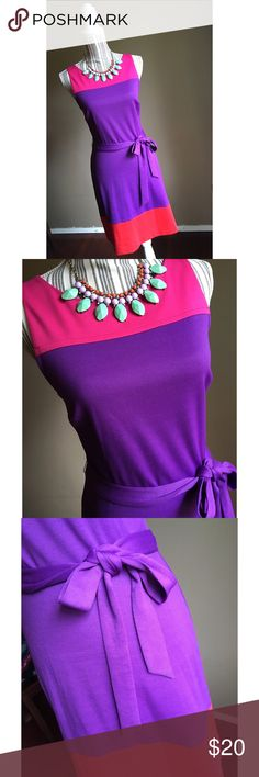 """Classy Color Block Dress Classy Color Block Dress by Elle. Size 10. Purple, pink, orange. Zips in the back. Belt can be tied in the front or the back. Bust 36"""" lying flat, stretches to 40"""". Shoulder to hem length 37"""". Elle Dresses"""