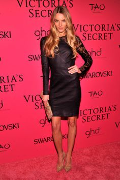 : Ieva Laguna opted for a black dress whose lacy sleeves let her skin peek through.
