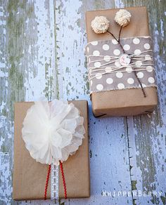 Brown paper wrap. Top with material and yarn. Then make pom poms out of that yarn, glue to a stick. The other is a wax paper flower, lace and ribbon. Easy