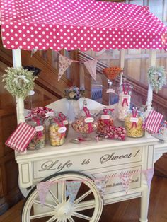 Vintage Sweet cart in cerise sitting perfectly at Coombe Lodge - can be colour themed to match your big day! Provided by Stacey from South West Chair Covers