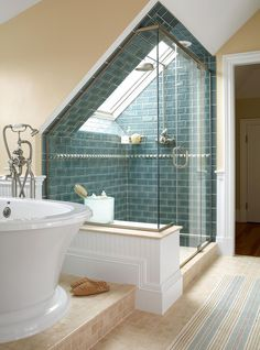 A skylight over this tiled shower provides abundant light and views of the nearby ocean, making it feel almost like showering outside. #bathroomdesign #bathroomideas #bathroomremodel #walkinshowerideas #showertileideas #bhg Attic Bathroom, Attic Rooms, Attic Spaces, Attic Shower, Shower Bathroom, Bathroom Ideas, Shower Window, Shower Tiles, Skylight Bathroom