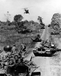 Vietnam war | Vietnam war part 1 | this picture looks like the U.S. tanks are on patrol also they are probably trying to avoid combat with who every they find.there is probably something over the hill because all the tanks have stopped and pulled over to the side of the road. I wonder what is over the hill?