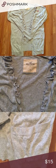 •HOLLISTER• Hollister cardigan with adorable ruffle detail and pockets! This is so versatile and can be added to any outfit. One of my favorite sweaters and is in good condition! Hollister Sweaters Cardigans