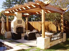 Amazing Patio For Outdoor Living Room With Black Chairs Plus Nattural Stone Fireplace - WakeCARES