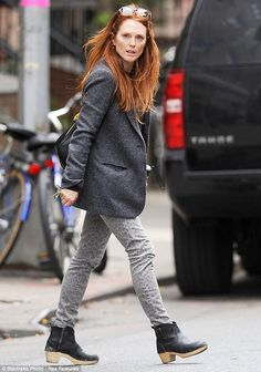 Casual chic: Julianne went for a casual chic look for her outing, slipping her slender figure into a pair of washed out leopard print jeans, a black T-shirt and grey jacket