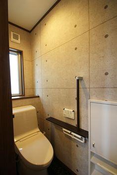 コンクリート打ちっぱなし柄のクロスで、おしゃれなトイレ。